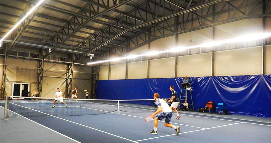 Sports Hall tennis players enjoy safe easy access play steel building